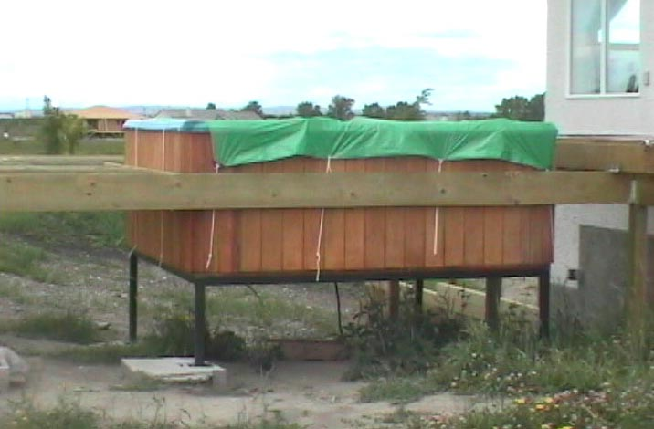 its taking a while to get this deck up heres a side shot of the hot tub steel frame aidan and i went out to paint it with the anti rust black